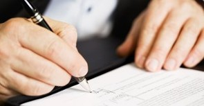 Signing Paperwork - Business Services